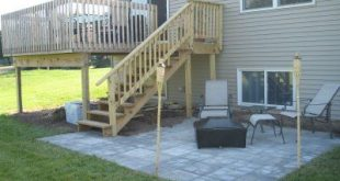deck and patio. Definitely want to redo our deck so the stairs come out like thi...
