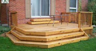 Low medium size single level deck with a cedar railing (#1R7115). reverse 201...