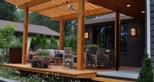 Concrete free floating steps lead to this beautiful cypress outside cantilevered...