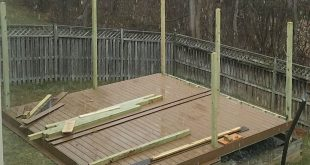 How to Build a DIY Floating Deck in a Sloped Backyard
