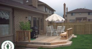 This simple, low to the ground cedar deck has access on both ends and offers abo...