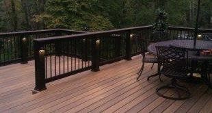 Tigerwood decking. Installed with hidden fastener system. Black composite post...