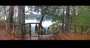 Wide angle - across the cedar deck, stairs to the ocean