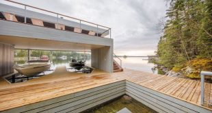Cibinel Architecture Have Designed A Modern Boathouse With An Elevated Entertain...