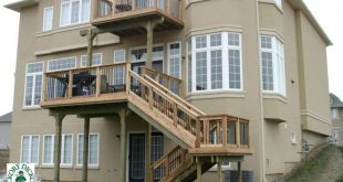 Large, two level deck with steps down to the yard (#2H6019).