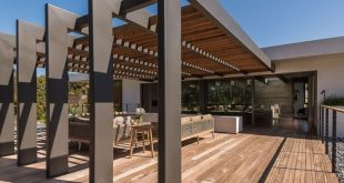 This large pergola has enough space for a large outdoor lounge and dining area. ...