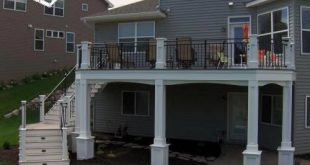 second story deck with curved around stairs, with in stairs lighting, white colu...